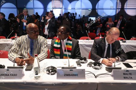(From L) President of Burkina Faso Roch Marc Christian Kabore, President of Zimbabwe Emmerson Mnangagwa and Prime Minister of Malta Joseph Muscat wait to attend the conference of Global Fund to Fight HIV, Tuberculosis and Malaria on october 10, 2019, in Lyon, central eastern France. - The Global Fund to Fight AIDS, Tuberculosis and Malaria opened a drive to raise $14 billion to fight a global epidemics but face an uphill battle in the face of donor fatigue. (