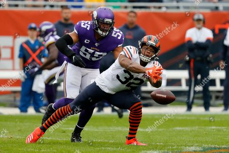 Chicago Bears running back David Montgomery (32) is unable to catch a pass as Minnesota Vikings outside linebacker Anthony Barr defends during the half of an NFL football game, in Chicago. Whether it's Michael Trubisky or Chase Daniel behind center, the Bears have to figure out a way to get their ground game going