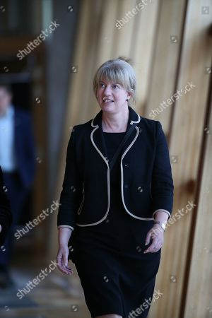 Scottish Parliament First Minister's Questions - Shona Robison makes her way to the Debating Chamber.
