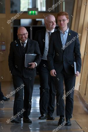 Scottish Parliament First Minister's Questions - Patrick Harvie, Co-convener of the Scottish Greens, Mark Ruskell and Ross Greer make their way to the Debating Chamber.