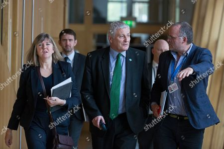 Stock Photo of Scottish Parliament First Minister's Questions - Alison Johnstone, John Finnie and Andy Wightman make their way to the Debating Chamber.