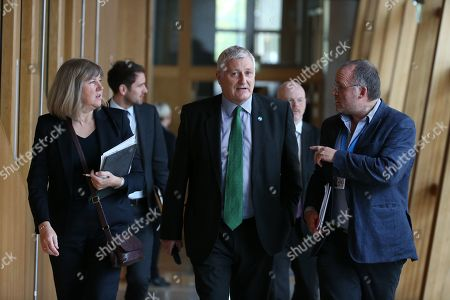 Scottish Parliament First Minister's Questions - Alison Johnstone, John Finnie and Andy Wightman make their way to the Debating Chamber.