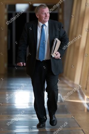 Stock Image of Scottish Parliament First Minister's Questions - Alex Rowley makes his way to the Debating Chamber.