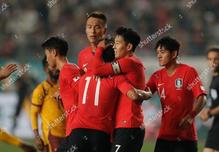 South Korea's Son Heung-min, center, celebrates with his teammates after scoring against Sri Lanka during their Asian zone Group H qualifying soccer match for the 2022 World Cup at Hwaseong Sports Complex in Hwaseong, South Korea