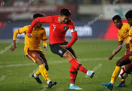 Son Heung-min, Mohamed Aman. South Korea's Son Heung-min, center, kicks the ball past Sri Lanka's Mohamed Aman, left, during their Asian zone Group H qualifying soccer match for the 2022 World Cup at Hwaseong Sports Complex Main Stadium in Hwaseong, South Korea