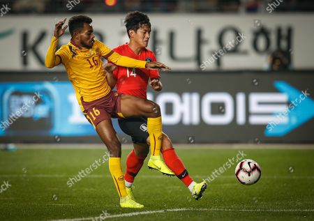 Hong Chul (R) of South Korea in action against Manaram Pathiranage (L) of Sri Lanka during the FIFA World Cup Qatar 2022 Group H qualification match match between South Korea and Sri Lanka at the Hwaaseong Sports complex on Hwaseong in Gyeonggi-do, South Korea, 10 October 2019.