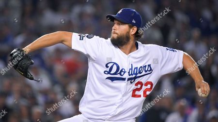 Los Angeles Dodgers pitcher Clayton Kershaw throws against the Washington Nationals during the seventh inning in Game 5 of baseball's National League Division Series, in Los Angeles