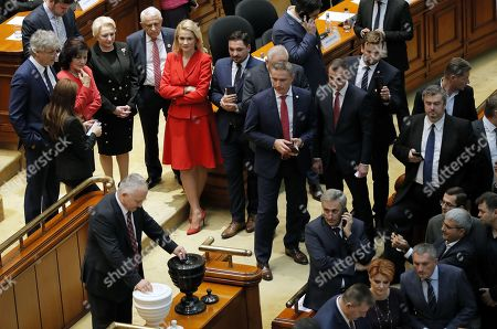 Romania's Prime Minister Viorica Dancila (2-L, upper row), surrounded by her cabinet members, watches the no-confidence vote procedure, held at Parliament Palace in Bucharest, Romania, 10 October 2019. The opposition parties pushed and passed a no-confidence vote against the ruling coalition after the junior partner of the ruling coalition, ALDE party, pulled out of the government in August, leaving the senior PSD party without a majority. The censure motion passed with 238 votes, five more than a minimum of 233 needed. According to the constitution, if a Cabinet is dismissed by a no-confidence vote in Parliament, it remains in office to manage the current public affairs, but without promoting new policies, adopting ordinances or initiating draft laws, until the new ministers will swear in.