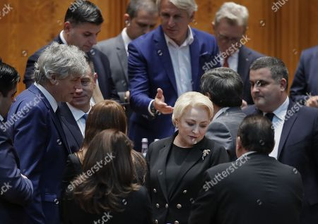 Romania's Prime Minister Viorica Dancila (C-R), surrounded  by her cabinet members, waits for the end announcement of the no-confidence vote, held at Parliament Palace in Bucharest, Romania, 10 October 2019. The opposition parties pushed and passed a no-confidence vote against the ruling coalition after the junior partner of the  ruling coalition, ALDE party, pulled out of the government in August, leaving the senior PSD party without a majority. The censure motion passed with 238 votes, five more than a minimum of 233 needed. According to the constitution, if a Cabinet is dismissed by a no-confidence vote in Parliament, it remains in office to manage the current public affairs, but without promoting new policies, adopting ordinances or initiating draft laws, until the new ministers will swear in.