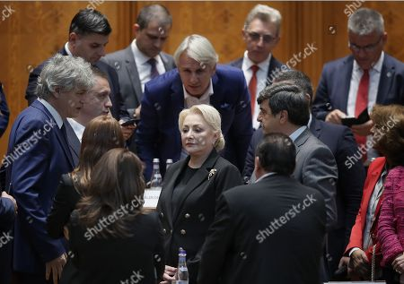 Romania's Prime Minister Viorica Dancila(C), backed by her cabinet members, waits for the end announcement of the no-confidence vote, held at Parliament Palace in Bucharest, Romania, 10 October 2019. The opposition parties pushed and passed a no-confidence vote against the ruling coalition after the junior partner of the  ruling coalition, ALDE party, pulled out of the government in August, leaving the senior PSD party without a majority. The censure motion passed with 238 votes, five more than a minimum of 233 needed. According to the constitution, if a Cabinet is dismissed by a no-confidence vote in Parliament, it remains in office to manage the current public affairs, but without promoting new policies, adopting ordinances or initiating draft laws, until the new ministers will swear in.