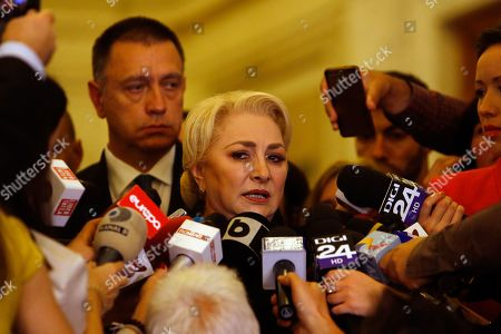 Romania's Prime Minister Viorica Dancila is surrounded by the media at the end of a no-confidence vote, held at Parliament Palace in Bucharest, Romania, 10 October 2019. The opposition parties pushed and passed a no-confidence vote against the ruling coalition after the junior partner of the ruling coalition, ALDE party, pulled out of the government in August, leaving the senior PSD party without a majority. The censure motion passed with 238 votes, five more than a minimum of 233 needed. According to the constitution, if a Cabinet is dismissed by a no-confidence vote in Parliament, it remains in office to manage the current public affairs, but without promoting new policies, adopting ordinances or initiating draft laws, until the new ministers will swear in.