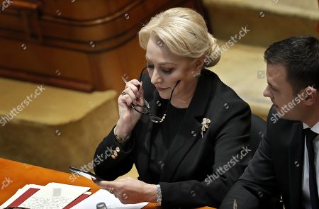 Romania's Prime Minister Viorica Dancila waits for the end announcement of the no-confidence vote, held at Parliament Palace in Bucharest, Romania, 10 October 2019. The opposition parties pushed and passed a no-confidence vote against the ruling coalition after the junior partner of the  ruling coalition, ALDE party, pulled out of the government in August, leaving the senior PSD party without a majority. The censure motion passed with 238 votes, five more than a minimum of 233 needed. According to the constitution, if a Cabinet is dismissed by a no-confidence vote in Parliament, it remains in office to to manage the current public affairs, but without promoting new policies, adopting ordinances or initiating draft laws, until the new ministers will swear in.