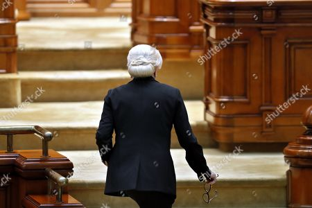 Romania's Prime Minister Viorica Dancila leaves the speaking desk after addressing  the lawmakers of both parliament chambers as she faces a no-confidence vote, at Parliament Palace in Bucharest, Romania, 10 October 2019. The opposition parties pushed and passed a no-confidence vote against the ruling coalition after the junior partner of the  ruling coalition, ALDE party, pulled out of the government in August, leaving the senior PSD party without a majority. The censure motion passed with 238 votes, five more than a minimum of 233 needed. According to the constitution, if a Cabinet is dismissed by a no-confidence vote in Parliament, it remains in office to to manage the current public affairs, but without promoting new policies, adopting ordinances or initiating draft laws, until the new ministers will swear in.