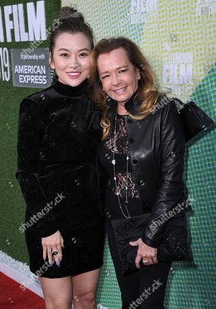 Melissa Shiyu Zuo and Caroline Scheufele