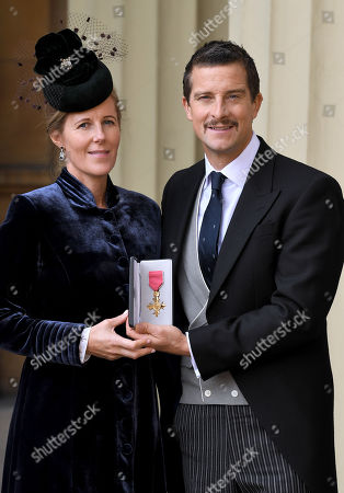 Bear Grylls, OBE and Shara Grylls, after an Investiture at Buckingham Palace.