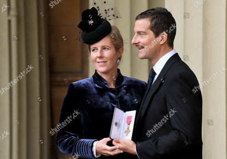 Stock Image of Bear Grylls, OBE and Shara Grylls, after an Investiture at Buckingham Palace.