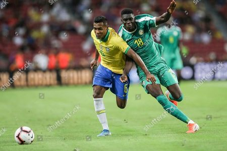 Stock Picture of Brazil's Alex Sandro, left, and Senegal's Ismaila Sarr in action during the Brazil Global Tour 2019 international friendly soccer match between Brazil and Senegal in Singapore