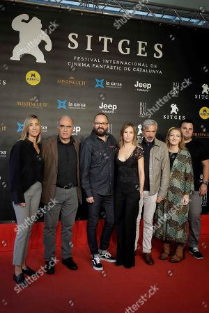 Fernando Gonzalez (3-L) poses with actors/cast members Francesc Orella (2-L), Marta Etura (C), Imanol Arias (3-R), and Nuria Valls (4-R), and producers Rosa Perez (L) and Adrian Guerra (R) during the premiere of the movie 'Legado en los huesos' (lit.: Legacy in the Bones) at the 52nd Sitges International Fantastic Film Festival of Catalonia, in Sitges near Barcelona, Spain, 10 October 2019. The film festival runs from 03 to 13 October.