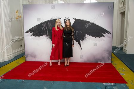 Elle Fanning, Angelina Jolie. Actresses Elle Fanning, left, and Angelina Jolie pose for photographers at the photo call for the film 'Maleficent Mistress of Evil' in central London