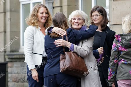 Stock Photo of Rebecca Thomas, the wife of Geraint Thomas, and his mother react after the end of the inquest, outside the Coroner's Court