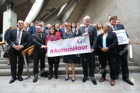 Stock Image of Autism Hour photocall at The Scottish Parliament - MSPs and Scottish political leaders including John Swinney, Deputy First Minister and Cabinet Secretary for Education and Skills, Patrick Harvie, Co-convener of the Scottish Greens, Jeane Freeman, Cabinet Secretary for Health and Sport, Nicola Sturgeon, First Minister of Scotland and Leader of the Scottish National Party (SNP), Jackson Carlaw, Interim Leader of the Scottish Conservative and Unionist Party, Annie Wells and Alexander Burnett