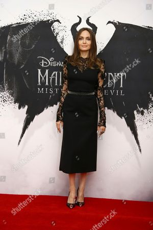 Angelina Jolie poses for photographers at the photo call for the film 'Maleficent Mistress of Evil' in central London