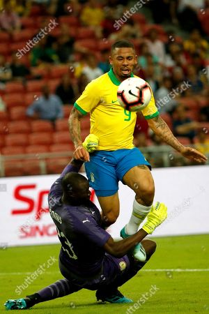 Stock Picture of Gabriel Jesus (top) of Brazil in action against Abdoulaye Diallo (bottom) of Senegal during an international friendly match at the National Stadium in Singapore, 10 October 2019.
