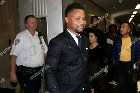 Cuba Gooding Jr. leaves a courtroom in New York, . The actor is accused of placing his hand on a 29-year-old woman's breast and squeezing it without her consent on June 9 in New York