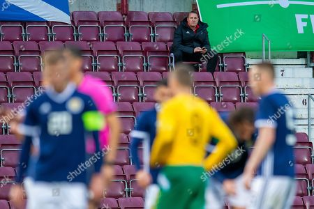 Scottish Football Association performance director Malky Mackay sits in an empty stand, and watches the U21 UEFA EUROPEAN CHAMPIONSHIPS match between U21 Scotland and U21 Lithuania at Tynecastle Park, Edinburgh
