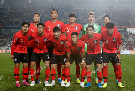 South Korea's national soccer team players front row from left, Lee Kang-in, Paik Seung-ho, Kim Moon-hwan, Hwang Hee-chan, Nam Tae-hee, Hong Chul, and back row from left, Kwon Kyung-won, Kim Shin-wook, Kim Min-jae, Jo Hyeon-woo, Son Heung-min pose prior to the start of the their Asian zone Group H qualifying soccer match between South Korea and Sri Lanka for the 2022 World Cup at Hwaseong Sports Complex Main Stadium in Hwaseong, South Korea