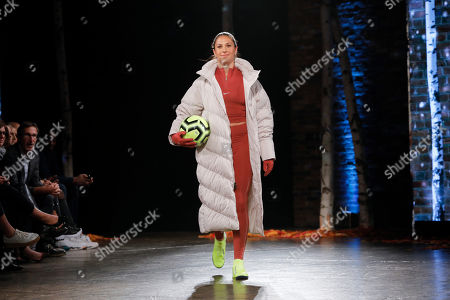 Women's soccer star Carli Lloyd struts down the runway in Nike at first-ever DICK'S Sporting Goods fashion show, in New York