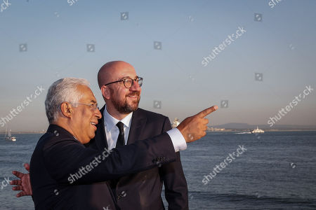 Portuguese Prime Minister Antonio Costa (L) chats with the elected president of the European Council, Belgian Prime Minister Charles Michel, during a walk in the center of Lisbon, Portugal, 10 October 2019.