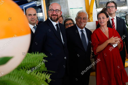 Portuguese Prime Minister Antonio Costa (C), flanked by Minister of Economy, Pedro Siza Vieira (L), chats with the elected president of the European Council, Charles Michel (2L), during a visit to the Second Home Lisboa, in Lisbon, Portugal, 10 October 2019.