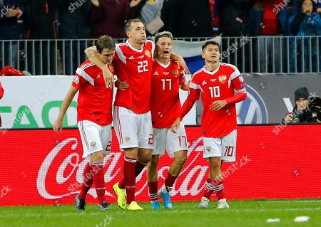 Russia's Aleksandr Golovin, second right, celebrates with teammates after scoring his side's fourth goal during the Euro 2020 group I qualifying soccer match between Russia and Scotland at the Luzhniki Stadium in Moscow, Russia