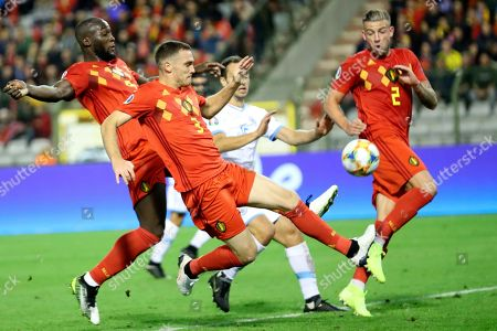 Belgium's Romelo Lukaku, left, and Belgium's Thomas Vermaelen, second left, go after the ball during the Euro 2020 group I qualifying soccer match between Belgium and San Marino at the King Baudouin Stadium in Brussels