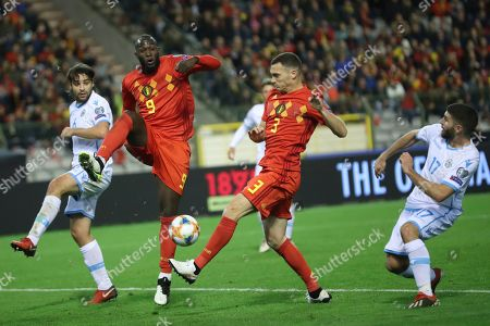 Belgium's Romelo Lukaku, second left, and Belgium's Thomas Vermaelen, center right, go after the ball during the Euro 2020 group I qualifying soccer match between Belgium and San Marino at the King Baudouin Stadium in Brussels