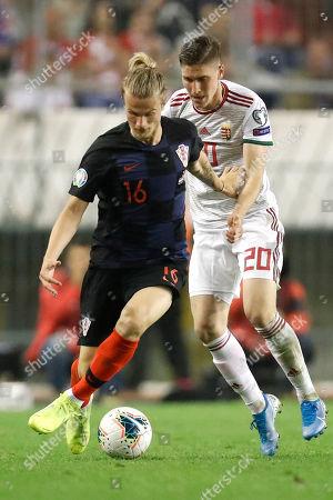 Tin Jedvaj, Roland Sallai. Croatia's Tin Jedvaj, left, fights for the ball with Hungary's Roland Sallai during the Euro 2020 group E qualifying soccer match between Croatia and Hungary at Poljud stadium in Split, Croatia
