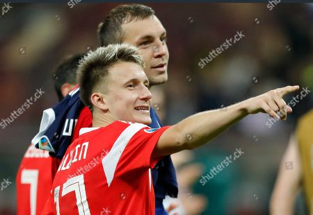 Russia's Artem Dzyuba, right, and Aleksandr Golovin celebrate their 4-0 victory in the Euro 2020 group I qualifying soccer match between Russia and Scotland at the Luzhniki Stadium in Moscow, Russia