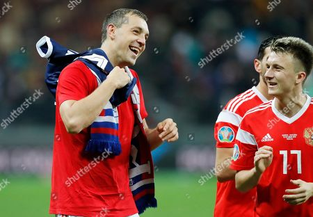 Russia's Artem Dzyuba, left, and Aleksandr Golovin celebrate their 4-0 victory in the Euro 2020 group I qualifying soccer match between Russia and Scotland at the Luzhniki Stadium in Moscow, Russia