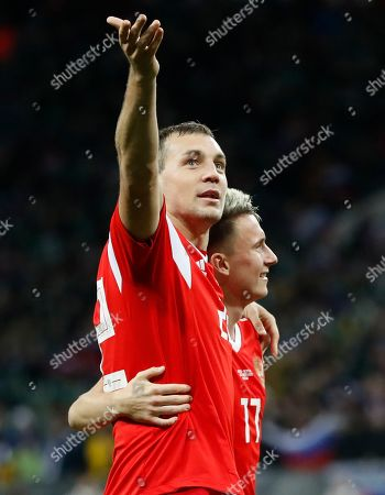 Russia's Artem Dzyuba, left, and Russia's Aleksandr Golovin celebrate their side's fourth goal scored by Aleksandr Golovin, right, during the Euro 2020 group I qualifying soccer match between Russia and Scotland at the Luzhniki Stadium in Moscow, Russia