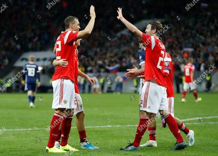 Russia's players celebrate their side's fourth goal scored by Aleksandr Golovin during the Euro 2020 group I qualifying soccer match between Russia and Scotland at the Luzhniki Stadium in Moscow, Russia