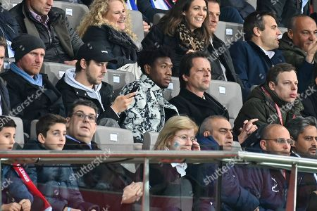 Bayern Munich's and Austria's David Alaba (C-L) and Peter Schoettel (C-R), sports director of Austria, watch the UEFA EURO 2020 group G qualifying soccer match between Austria and Israel in Vienna, Austria, 10 October 2019.