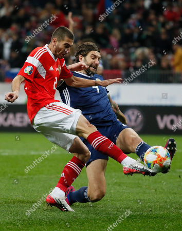 Alexei Ionov (L) of Russia ia action against Charlie Mulgrew (R) of Scotland during the UEFA 2020 Qualifying round - Group I soccer match of Russian and Scotch national teams at Luzhniki stadium in Moscow, Russia, 10 October 2019.