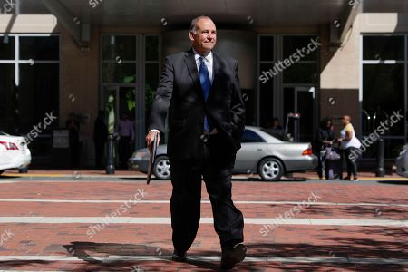 Thomas Zehnle, an attorney representing Lev Parnas and Igor Fruman, arrives at the federal courthouse in Alexandria, Va., . The two Florida businessmen, tied to President Donald Trump's personal lawyer Rudy Giuliani, have been arrested on campaign finance violations resulting from a $325,000 donation to a political action committee supporting President Donald Trump's re-election