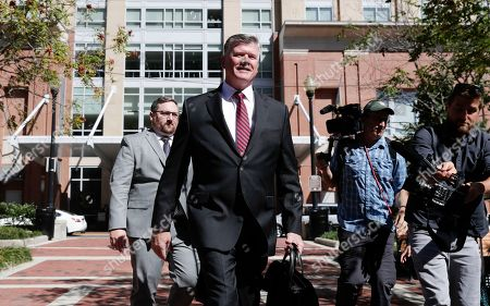 Kevin Downing, center, attorney representing two Florida businessmen, Lev Parnas and Igor Fruman, arrives at the federal courthouse in Alexandria, Va., . The two Florida businessmen, tied to President Donald Trump's personal lawyer Rudy Giuliani, have been arrested on campaign finance violations resulting from a $325,000 donation to a political action committee supporting President Donald Trump's re-election