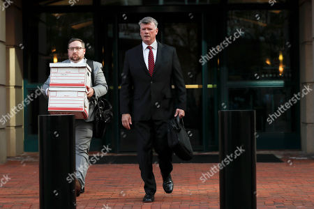 Kevin Downing, center, an attorney representing two Florida businessmen, Lev Parnas and Igor Fruman, leaves the federal courthouse in Alexandria, Va., . Two Florida businessmen tied to President Donald Trump's personal lawyer Rudy Giuliani have been arrested on campaign finance violations resulting from a $325,000 donation to a political action committee supporting Trump's re-election
