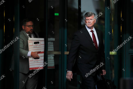 Kevin Downing, right, am attorney representing two Florida businessmen Lev Parnas and Igor Fruman, leaves the federal courthouse in Alexandria, Va., . Two Florida businessmen tied to President Donald Trump's personal lawyer Rudy Giuliani have been arrested on campaign finance violations resulting from a $325,000 donation to a political action committee supporting Trump's re-election