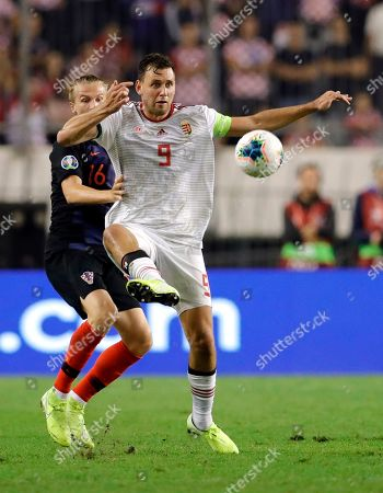 Croatia's Tin Jedvaj (L)  in action against Hungary's Adam Szalai (R) during the UEFA Qualification soccer match group E for EURO 2020 between Croatia and Hungary at Poljud stadium in Split, Croatia, 10 October 2019.