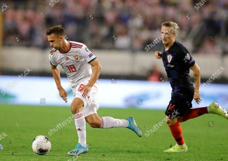 Croatia's  Tin Jedvaj (R)  in action against Hungary's Dominik Nagy (L) during the UEFA Qualification soccer match group E for EURO 2020 between Croatia and Hungary at Poljud stadium in Split, Croatia, 10 October 2019.