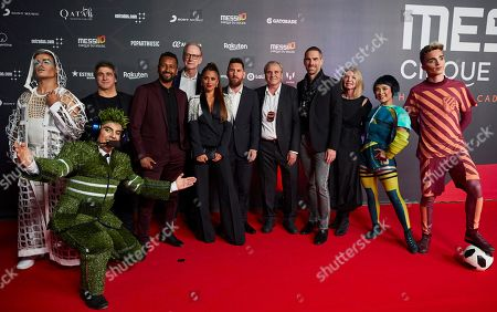 FC Barcelona's forward Lionel Messi (6-R) from Argentina and his wife Antonela Rocuzzo (7-R) pose for the media with Cirque du Soleil members upon arrival to the premiere of the Cirque du Soleil 'Messi 10' spectacle in Barcelona, Catalonia, Spain, 10 October 2019.